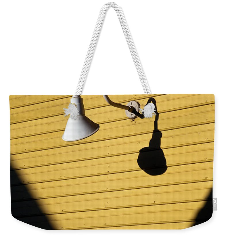 Sunlamp Weekender Tote Bag featuring the photograph Sun Lamp by Dave Bowman