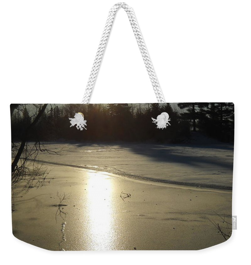 Sun Weekender Tote Bag featuring the photograph Sun Reflecting Off River Ice by Kent Lorentzen