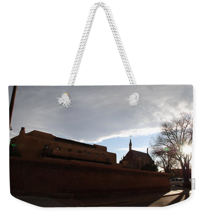 New Mexico Weekender Tote Bag featuring the photograph Sun Thru The Trees by Rob Hans