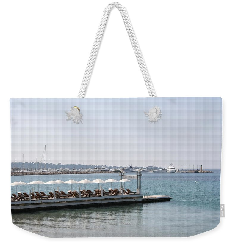 Sunbed Weekender Tote Bag featuring the photograph Sunbathing In A Row by Christiane Schulze Art And Photography