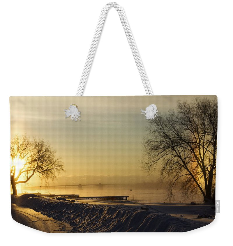 Sun Weekender Tote Bag featuring the photograph Sundog On The Bay by Tim Nyberg