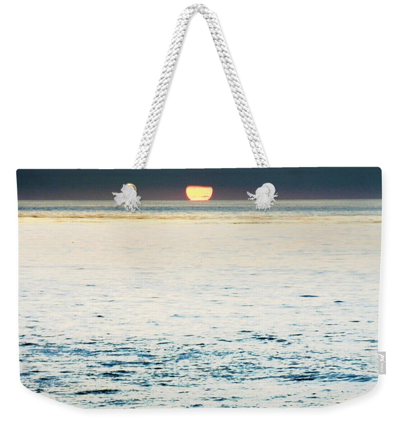 Sunset Weekender Tote Bag featuring the photograph Sundown by Anthony Jones