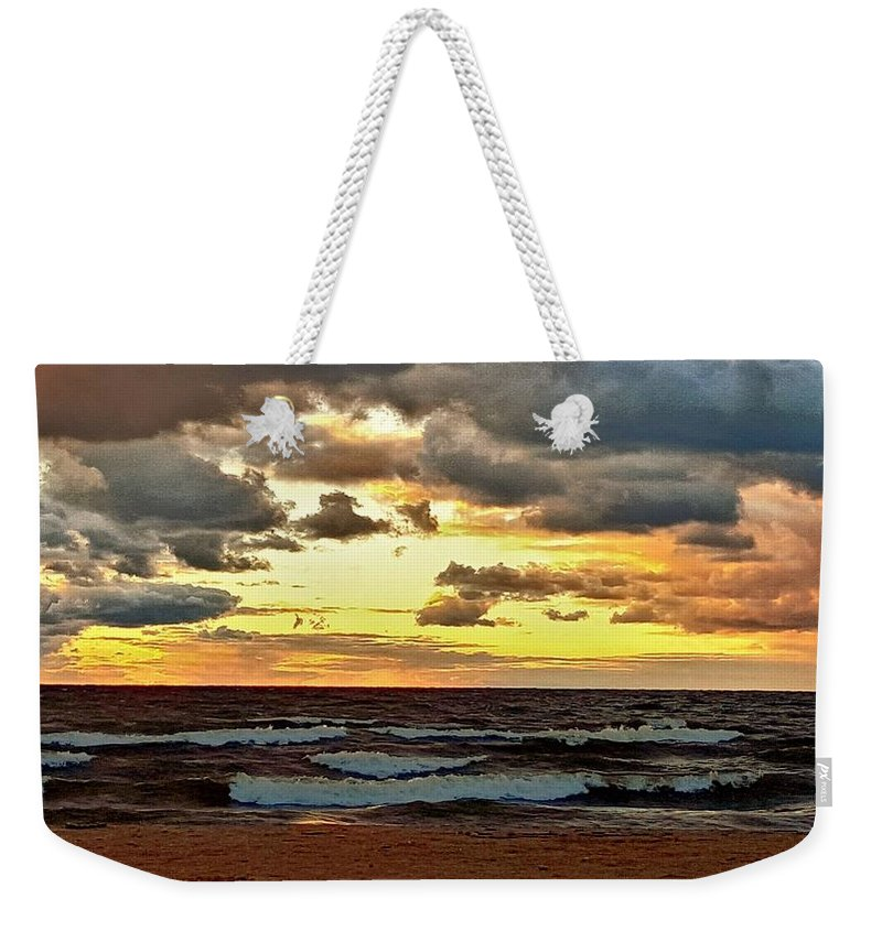 Ocean Weekender Tote Bag featuring the photograph Sundown by Dani McEvoy