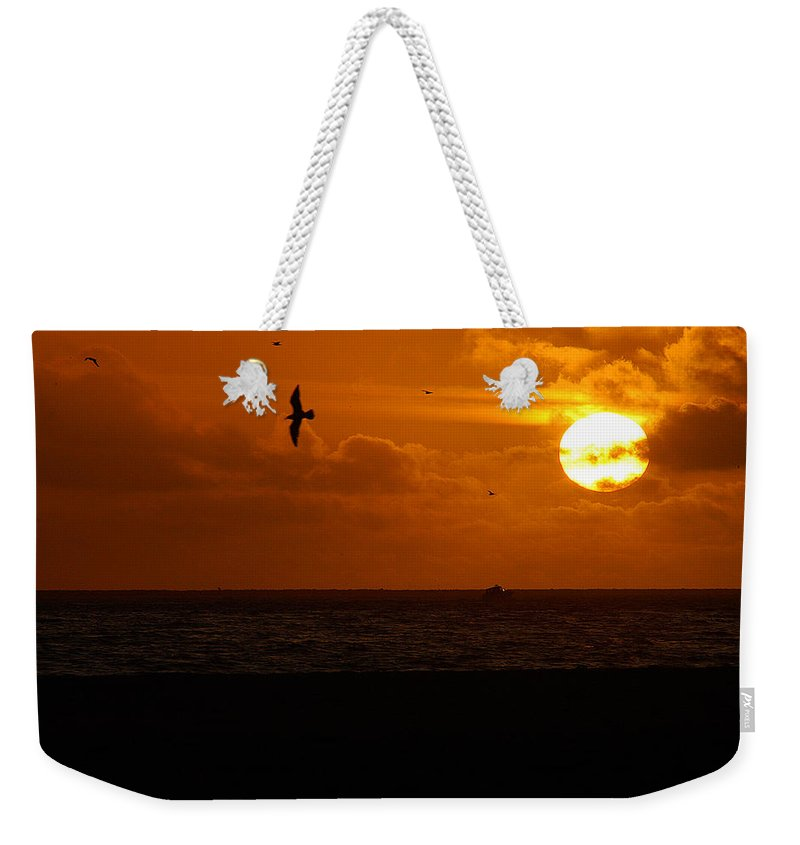 Clay Weekender Tote Bag featuring the photograph Sundown Flight by Clayton Bruster