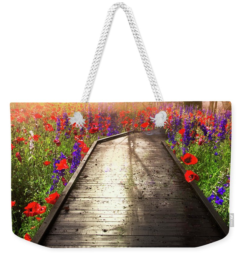 Appalachia Weekender Tote Bag featuring the photograph Sunlit Wildflowers by Debra and Dave Vanderlaan