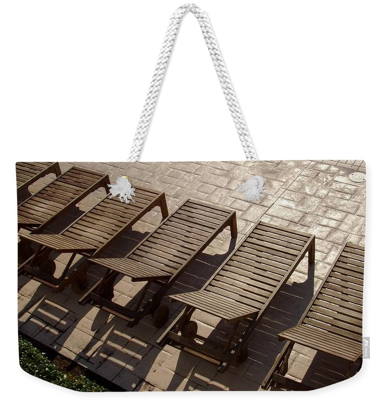 Swimming Pool Weekender Tote Bag featuring the photograph Sunning Chairs by Deborah Crew-Johnson