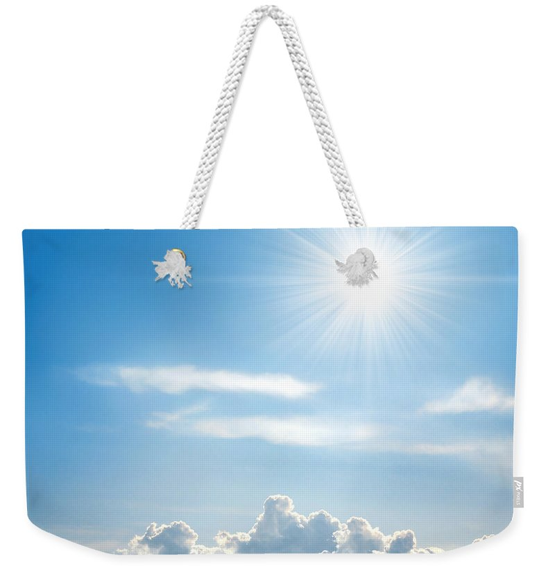 Background Weekender Tote Bag featuring the photograph Sunny Sky by Carlos Caetano