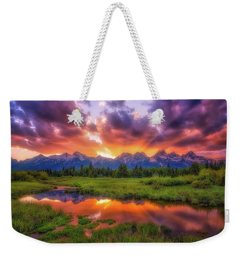 Sunset Weekender Tote Bag featuring the photograph Sunrays Over The Tetons by Darren White