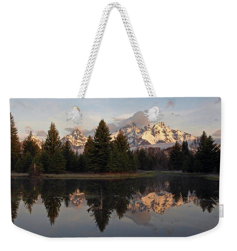 Teton Weekender Tote Bag featuring the photograph Sunrise Along The Range by DeeLon Merritt