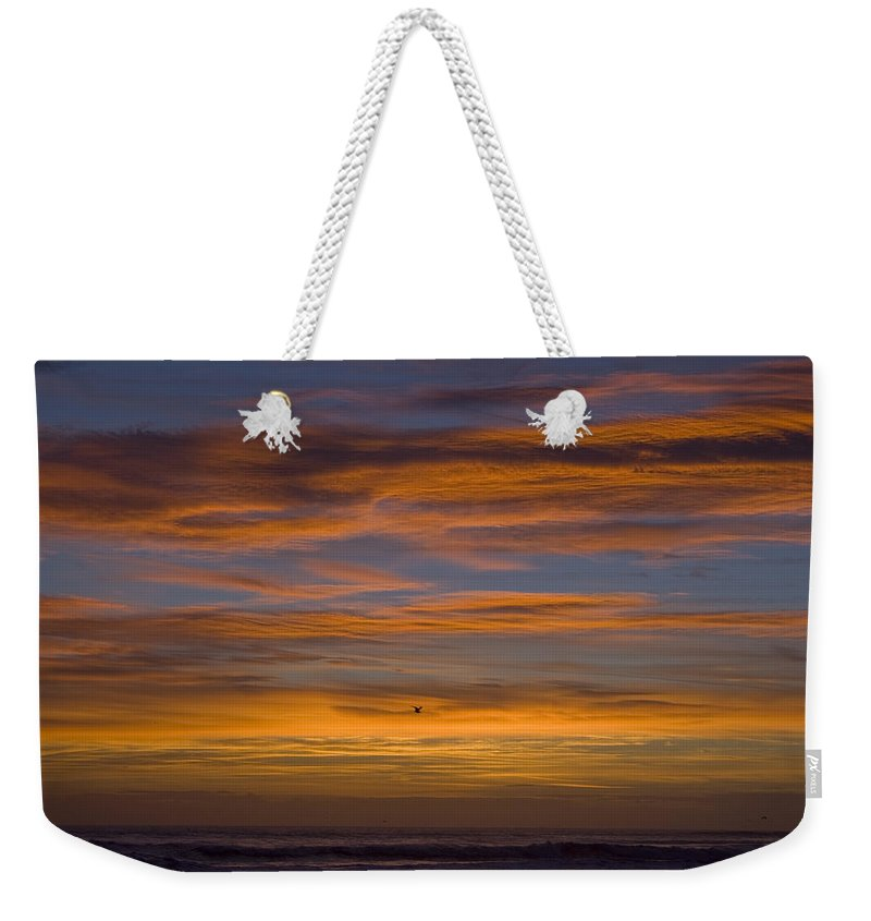 Sun Sunrise Cloud Clouds Morning Early Bright Orange Bird Flight Fly Flying Blue Ocean Water Waves Weekender Tote Bag featuring the photograph Sunrise by Andrei Shliakhau