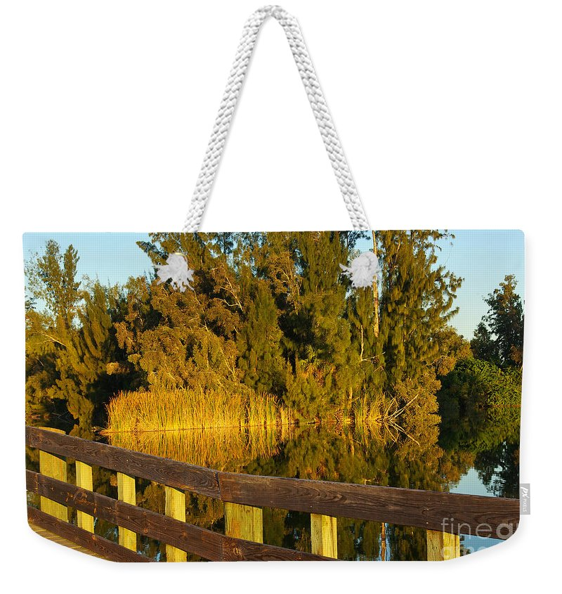 Lake Weekender Tote Bag featuring the photograph Sunrise At A Lake by Zal Latzkovich