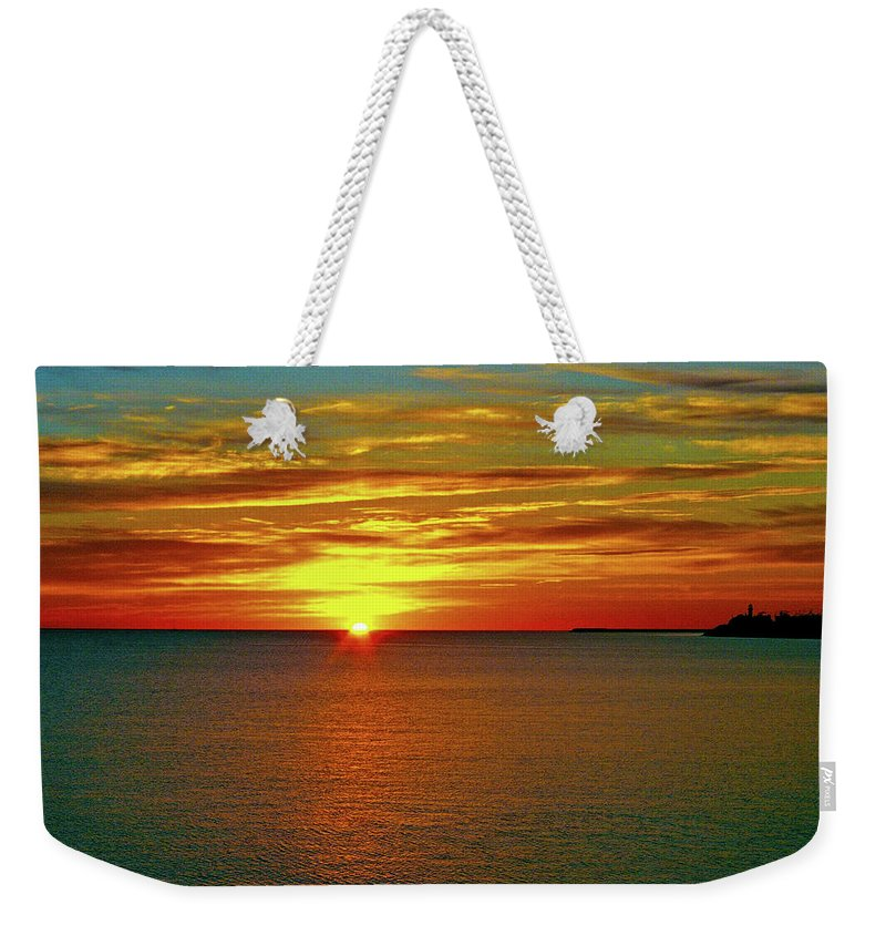 North America Weekender Tote Bag featuring the photograph Sunrise At Matane by Juergen Weiss