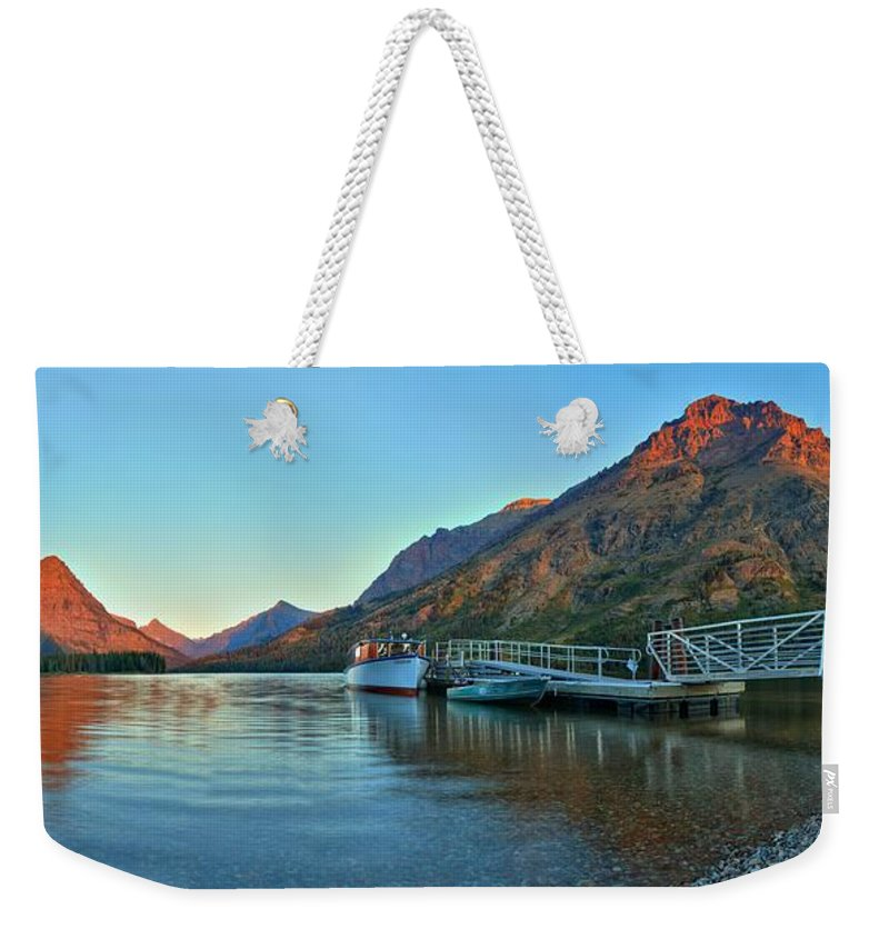 Two Medicine Weekender Tote Bag featuring the photograph Sunrise At The Two Medicine Dock by Adam Jewell