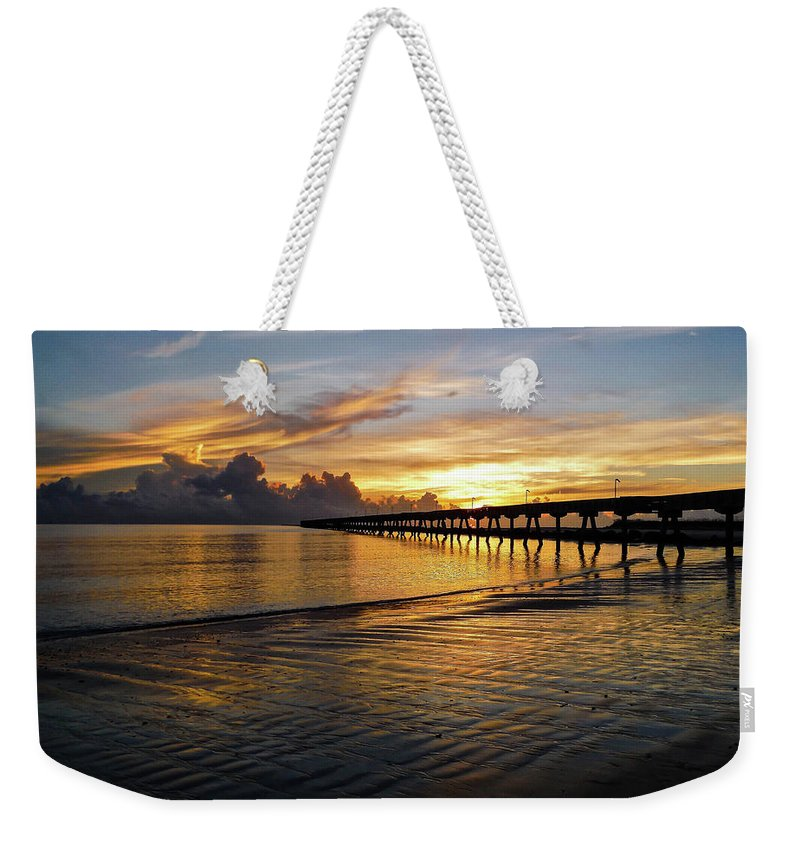 Sunrise Weekender Tote Bag featuring the photograph Sunrise Fort Clinch Pier by Timothy Cummiskey