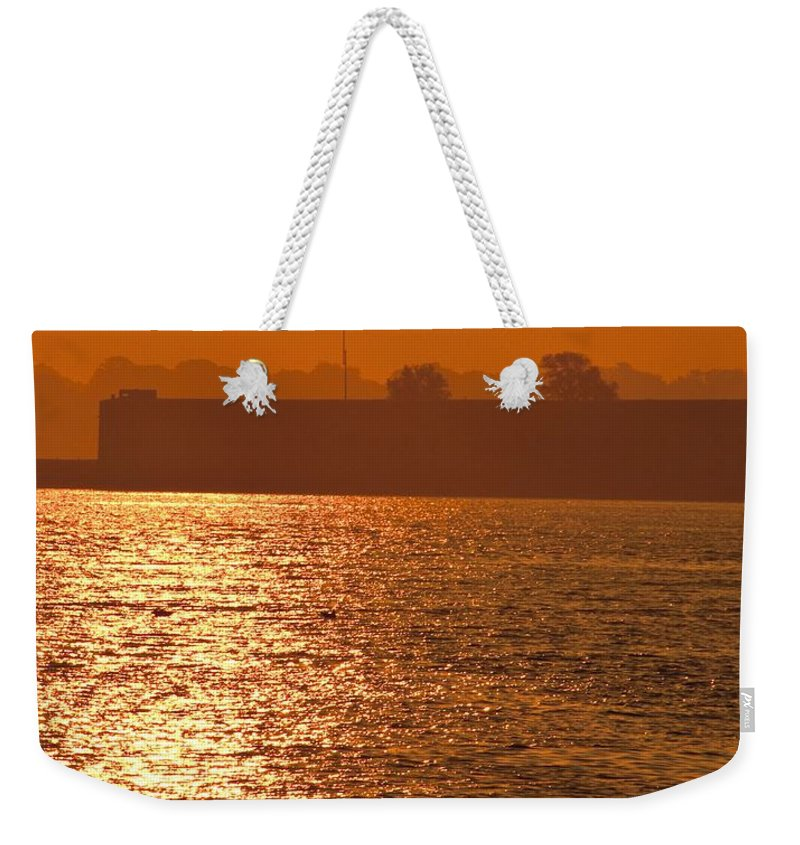 Sunrise Weekender Tote Bag featuring the photograph Sunrise Ft Adams by Steven Natanson
