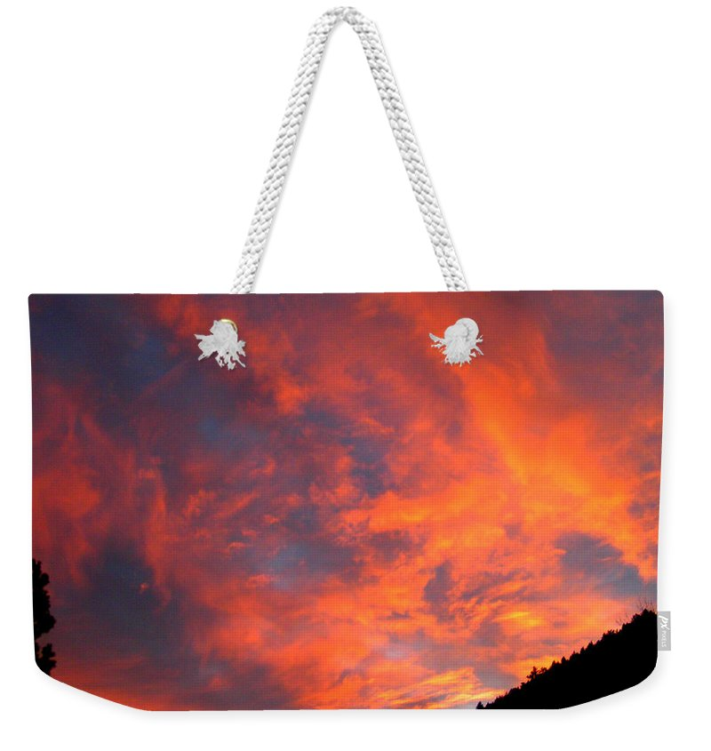 Sunrise Clouds Colorado Rocky Mountains Nature Zen Simple Colorful Big Sky Weekender Tote Bag featuring the photograph Sunrise by George Tuffy