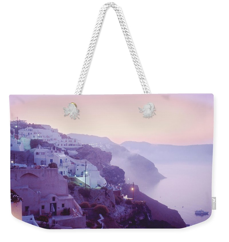 Oia Weekender Tote Bag featuring the photograph Sunrise In Oia by Yuri Lev