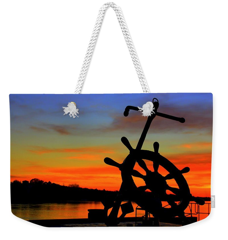 Sunrise Weekender Tote Bag featuring the photograph Sunrise Over The Captain's Wheel by Suzanne DeGeorge