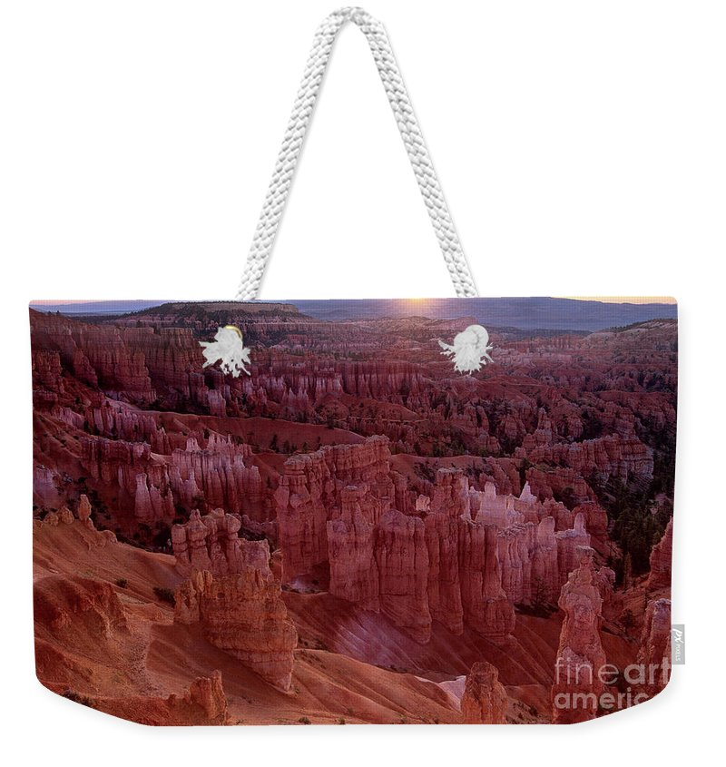 North America Weekender Tote Bag featuring the photograph Sunrise Over The Hoodoos Bryce Canyon National Park by Dave Welling