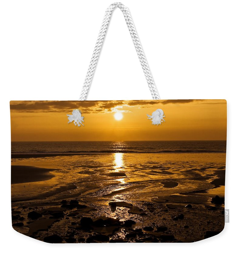 Dawn Weekender Tote Bag featuring the photograph Sunrise Over The Sea by Svetlana Sewell