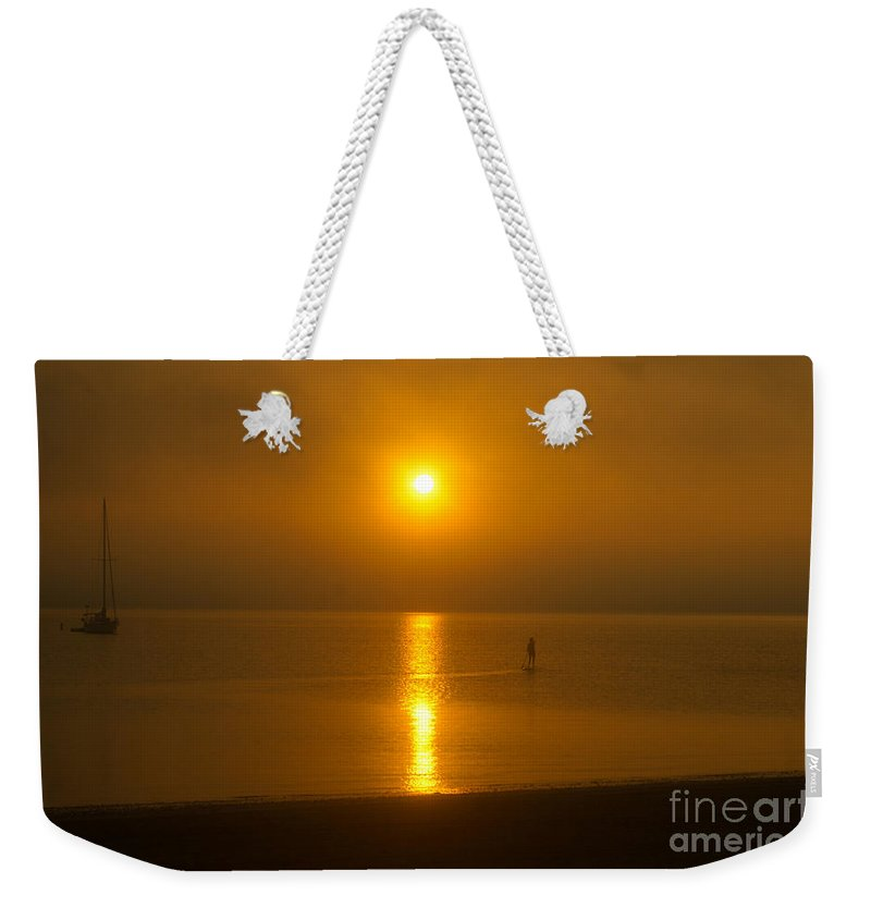 Sun Weekender Tote Bag featuring the photograph Sunrise Paddler 2 by Ray Konopaske