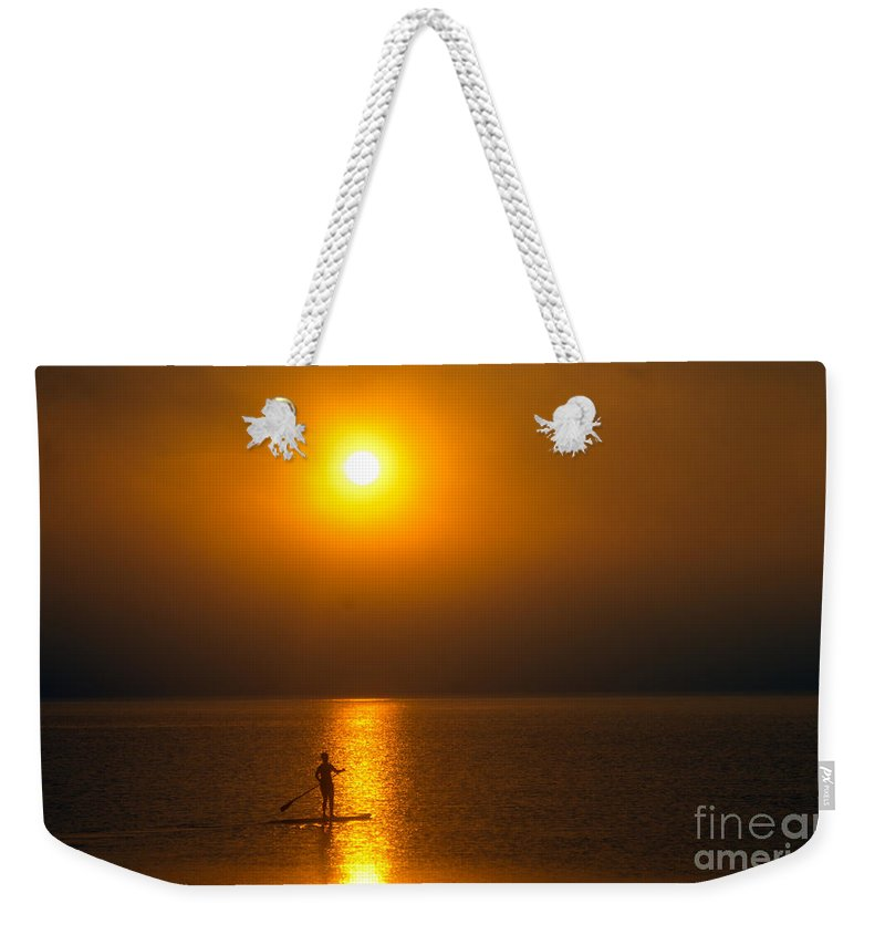 Sun Weekender Tote Bag featuring the photograph Sunrise Paddler by Ray Konopaske