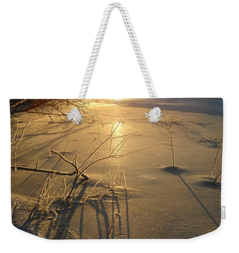 Ice Weekender Tote Bag featuring the photograph Sunrise Reflecting Off Mississippi River Ice by Kent Lorentzen