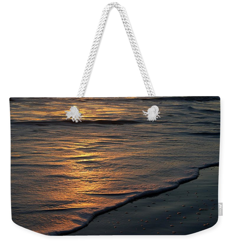 Ocean Beach Sun Sunrise Reflection Wave Tide Bright Orange Gold Water Vacation Weekender Tote Bag featuring the photograph Sunrise Waves by Andrei Shliakhau