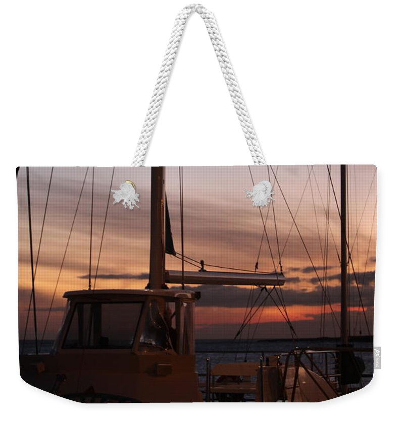 Sunset Weekender Tote Bag featuring the photograph Sunset And Sailboat by Nadine Rippelmeyer