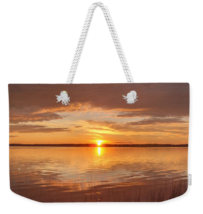 Lake Water Shore Reeds Beach Sunset Sky Weekender Tote Bag featuring the photograph Sunset by Andrea Lawrence