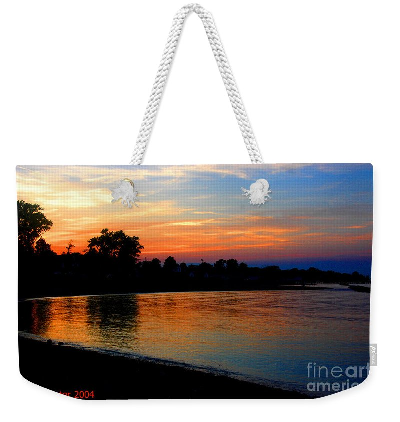 Clay Weekender Tote Bag featuring the photograph Sunset At Colonial Beach Cove by Clayton Bruster