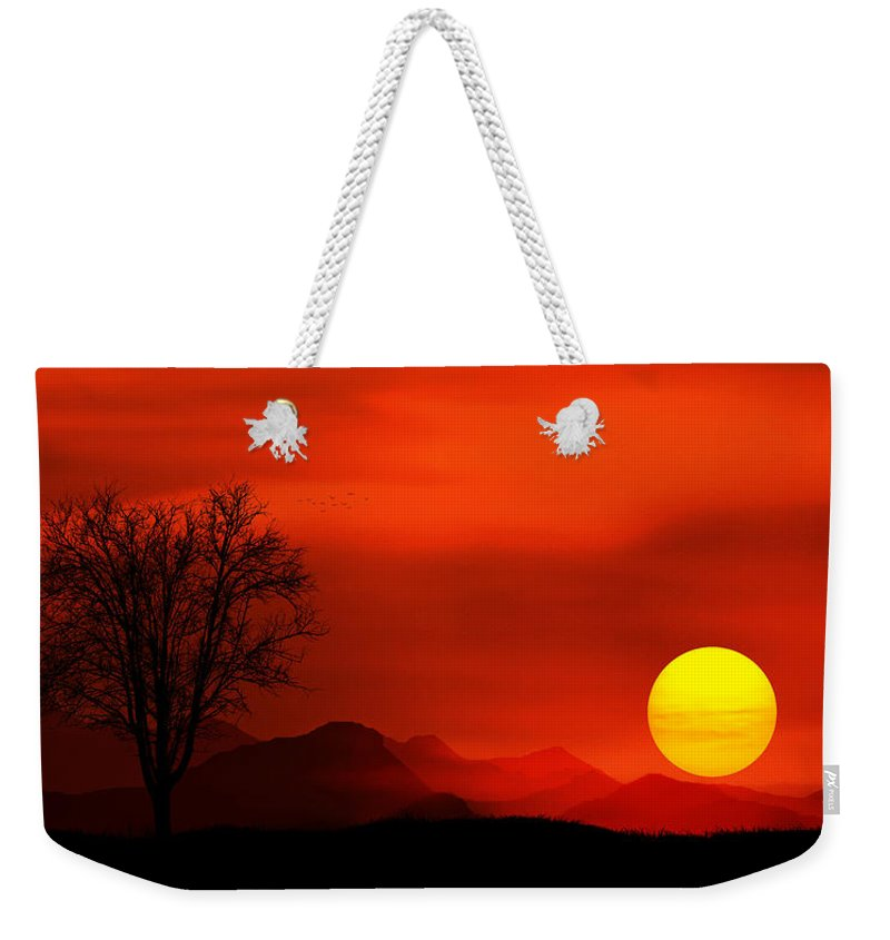 Sunlight Weekender Tote Bag featuring the photograph Sunset by Bess Hamiti