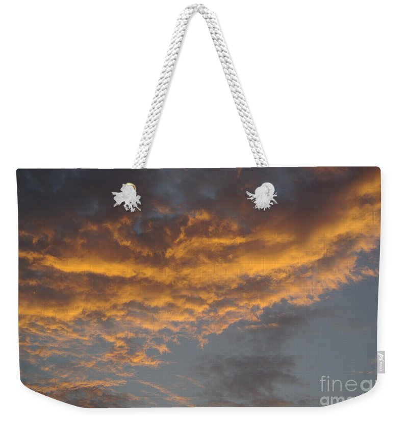 Clouds Weekender Tote Bag featuring the photograph Sunset Clouds by Jim And Emily Bush