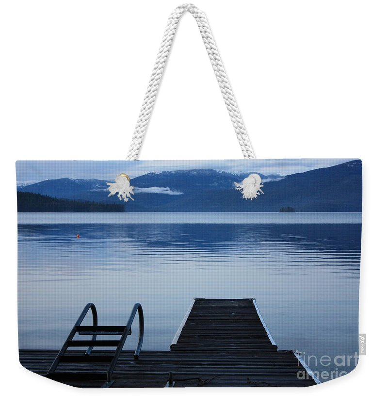 Priest Lake Weekender Tote Bag featuring the photograph Sunset Dock At Priest Lake by Carol Groenen