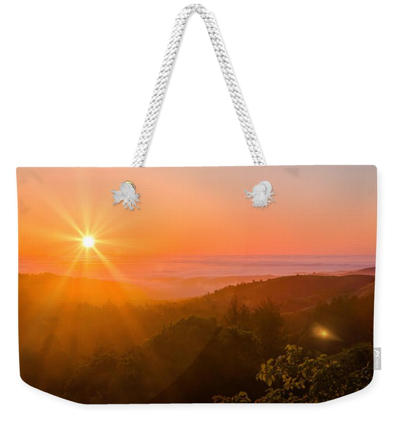 Pacific Weekender Tote Bag featuring the photograph Sunset Fog Over The Pacific #1 by Bryant Coffey