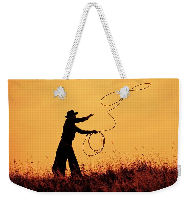 Old Cowboy Weekender Tote Bag featuring the photograph Sunset Lariat 4 by Ruth Eich