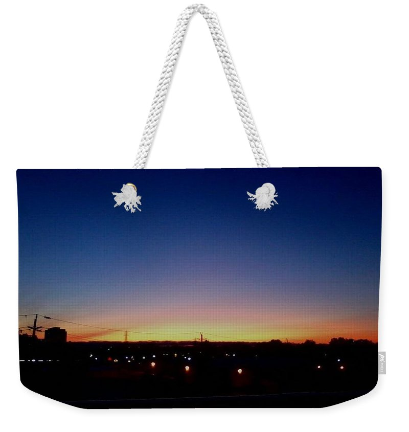 Sky Weekender Tote Bag featuring the photograph Sunset by Maryam Al Azzawi