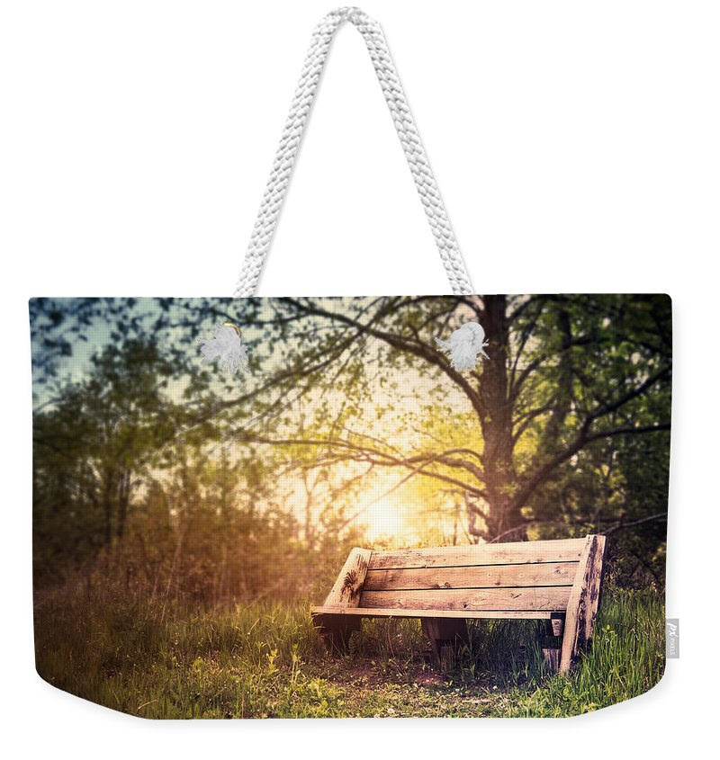 Landscape Weekender Tote Bag featuring the photograph Sunset On A Wooden Bench by Scott Norris