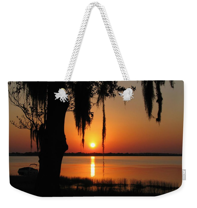 Nature Weekender Tote Bag featuring the photograph Sunset On Lake Minneola by Peg Urban