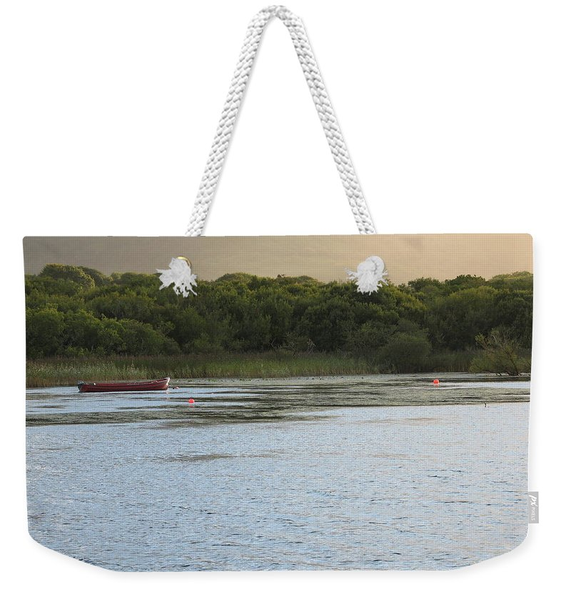 Boat Weekender Tote Bag featuring the photograph Sunset Over Killarney by Kelly Mezzapelle