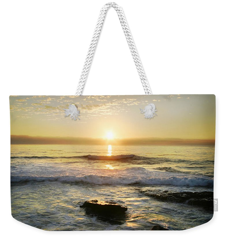 Sunset Weekender Tote Bag featuring the photograph Sunset Over The Ocean by Anthony Jones
