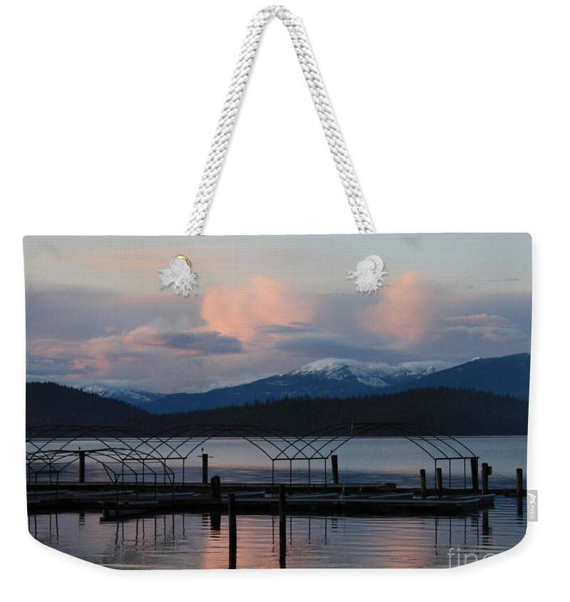 Priest Lake Weekender Tote Bag featuring the photograph Sunset Reflecting Off Priest Lake by Carol Groenen