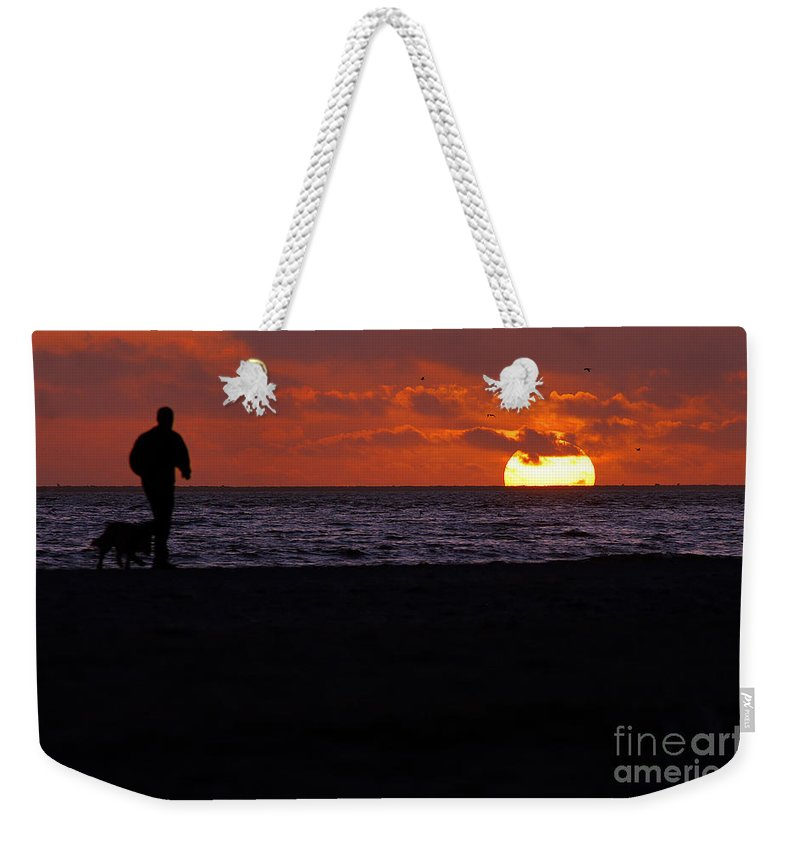 Clay Weekender Tote Bag featuring the photograph Sunset Run by Clayton Bruster
