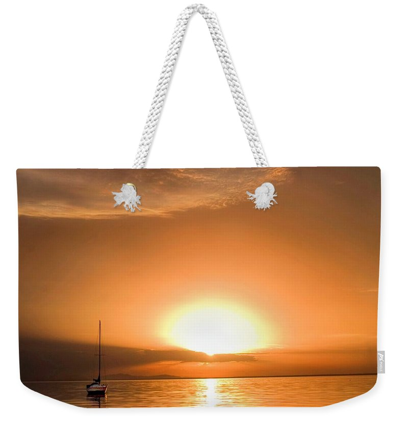 Seascape Weekender Tote Bag featuring the photograph Sunset Sail by Dolly Sanchez