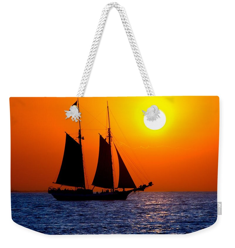 Yellow Weekender Tote Bag featuring the photograph Sunset Sailing In Key West Florida by Michael Bessler