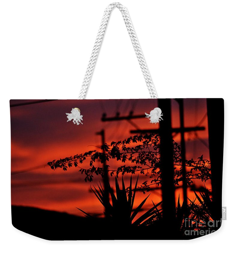Clay Weekender Tote Bag featuring the photograph Sunset Sihouettes by Clayton Bruster