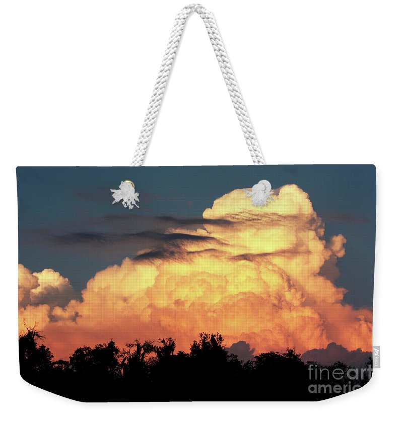Sunset Weekender Tote Bag featuring the photograph Sunset Storm Clouds Over The Marsh by Carol Groenen