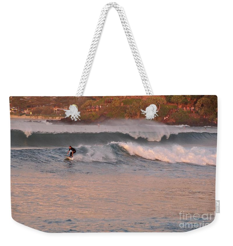 Gold Coast Weekender Tote Bag featuring the photograph Sunset Surfing by Csilla Florida