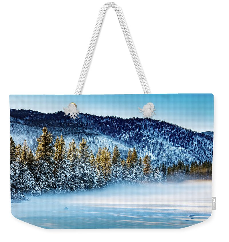 Sunset Weekender Tote Bag featuring the photograph Sunset Through Trees by Mike Penney