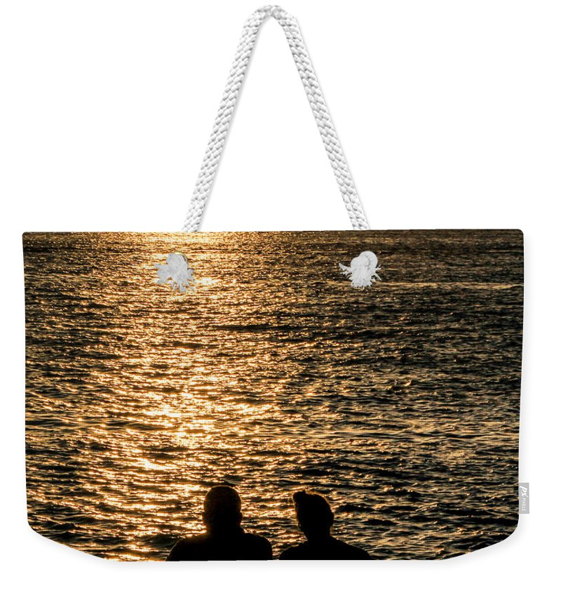 Beach Weekender Tote Bag featuring the photograph Sunset Together In Key West by Bob Slitzan